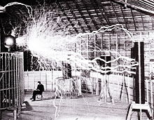 Publicity photo of Nikola Tesla sitting in his laboratory in Colorado Springs in December 1899